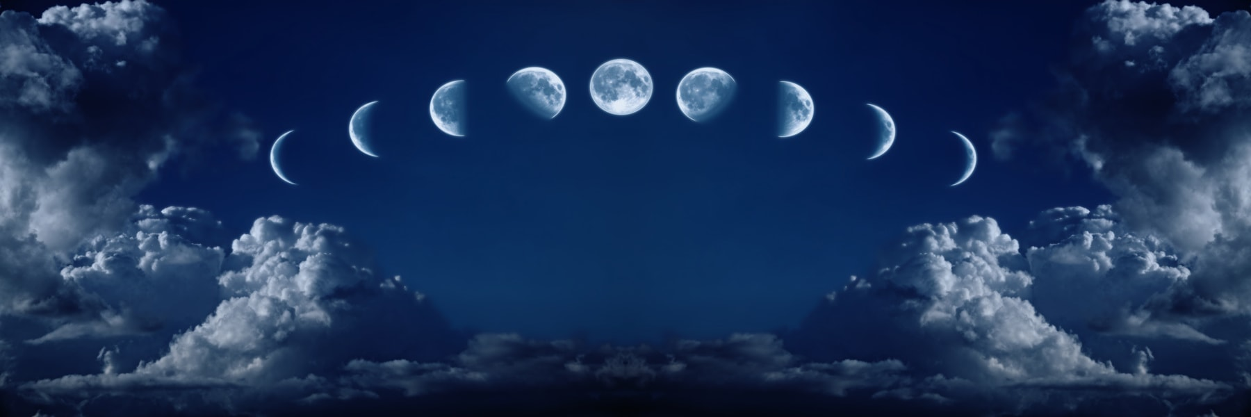 Nine phases of the full growth cycle of the moon isolated in the night sky with clouds
